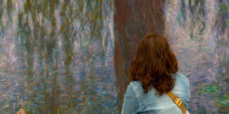 Woman viewing waterlilies