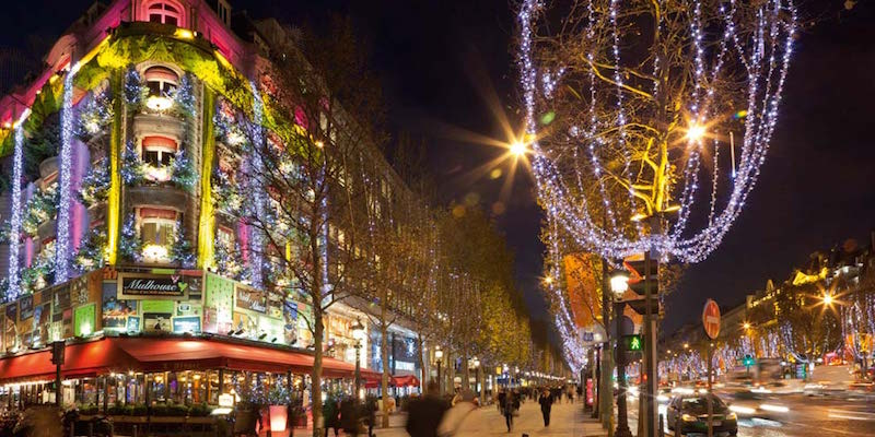 Paris street lit up by Christmas Lights